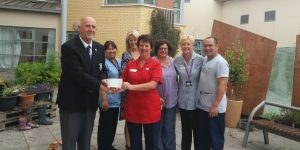 Past Captain Adrian Faulkner presents Charity Cheque to RABIU