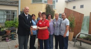 Past Captain Adrian Faulkner presents Charity Cheque to RABIU